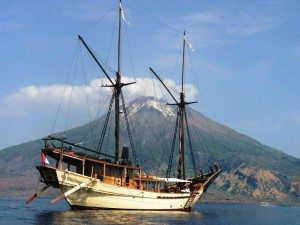 Charter Yacht Silolona anchored in front of active volcano www