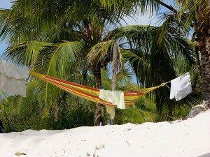 Canouan Relaxing on the Beach www.njcharters.com #DestinationConfidential #YachtCharter